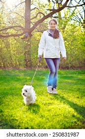 woman with west highland terrier