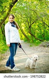 woman with west highland white terrier
