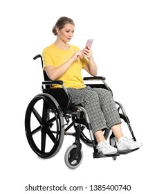 Woman in wheelchair with mobile phone isolated on white