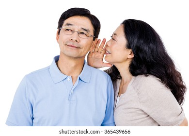 Woman whispering into her partners ear