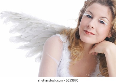 woman in white angel costume with wings shows white christmas