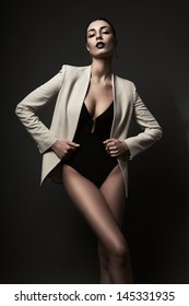 woman in white blazer and black body