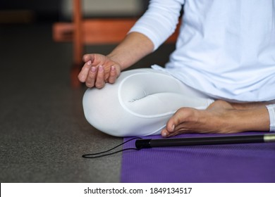 A woman in white clothes is doing kundalini yoga. Gong meditation. Asana for concentration. Healthy lifestyle, sports and stretching. Pody part