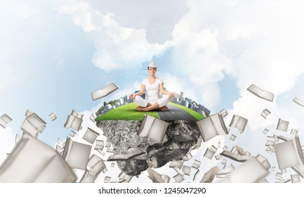 Woman in white clothing keeping eyes closed and looking concentrated while meditating on island in the air among flying books with cloudy skyscape on background. 3D rendering.