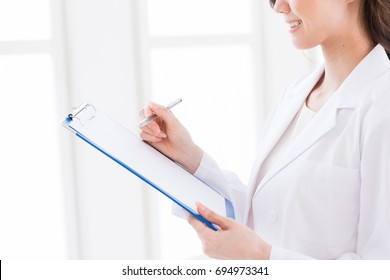 woman in a white coat,interview sheet