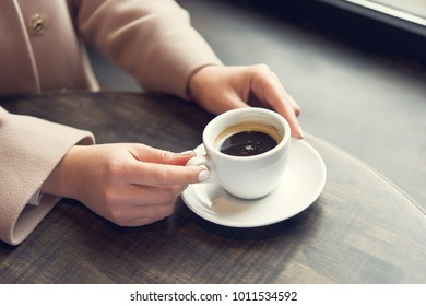 woman with white coffee cup on a table. lifestyle of business  lady. breakfast in the restaurant