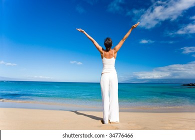 woman in white doing yoga on tropical beach
