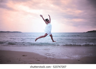 Woman in white dress at the beach