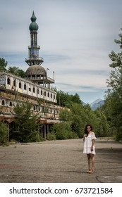 Woman in white dress in ghost town