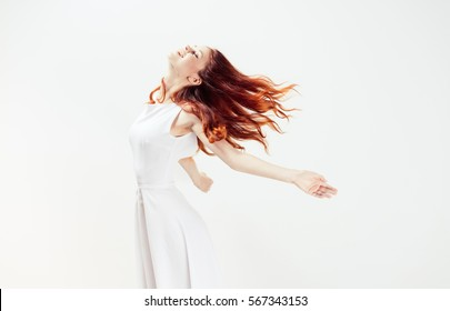 woman in a white dress on a white background