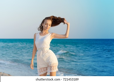 Woman in a white dress on beach