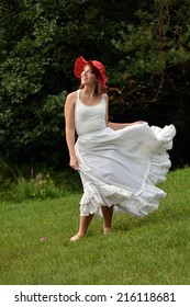 woman in white dress with red hat