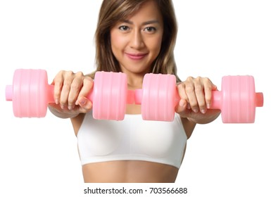 woman in white fitness clothes holding dumbbell in her hand