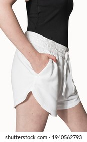 Woman in white gym shorts activewear photoshoot