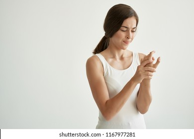 a woman in a white jersey kneads a paintbrush
