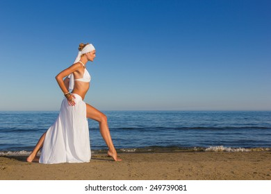 woman with white sarong on the beach