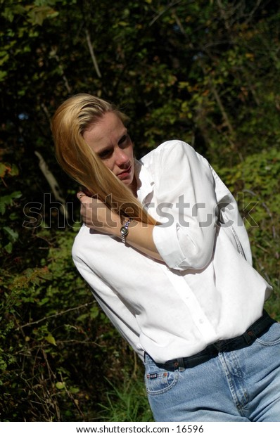 woman in white shirt, with blond hair