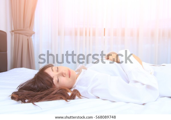woman in white shirt sleeping on her bedroom. concept for healthy.