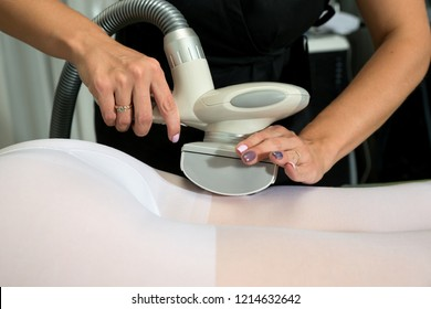 Woman in white suit getting anti cellulite massage in a beauty SPA salon. LPG, and body contouring treatment in clinic.  Lipomassage procedure on female body. Body care.