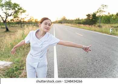 woman in white suit on road