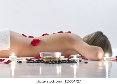 Woman in white towel relaxing in spa