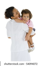 woman who could be her mother, nurse, nanny or teacher holding a sweet 2 girl, isolated on white background