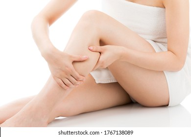 A woman who does skin care for her legs.