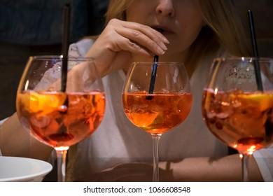 Woman who drink campari orange