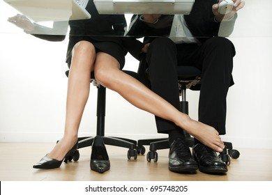 Woman who flirts in office with a colleague