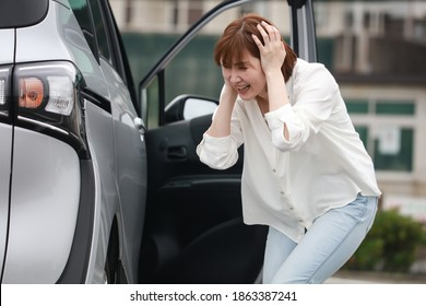 A woman who has hit a car