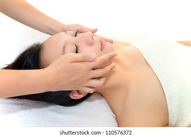 The woman who receives face massage