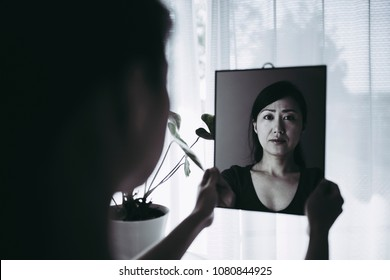 woman who is shocked by seeing a mirror