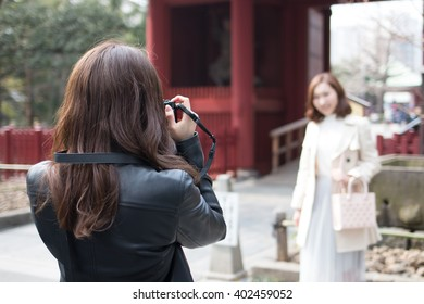 Woman who takes a photograph at a sightseeing spot