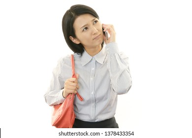 Woman who is talking on a smart phone.