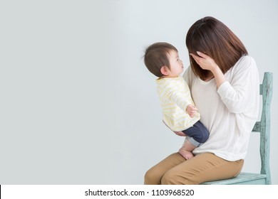 The woman who is troubled with child care and baby