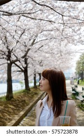 The woman who walks a row of cherry trees