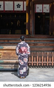 The woman who wear Japanese dress in shrine