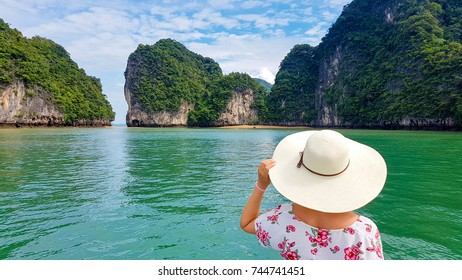 Woman with wide hat  admiring nature of Phang Nga, Thailand