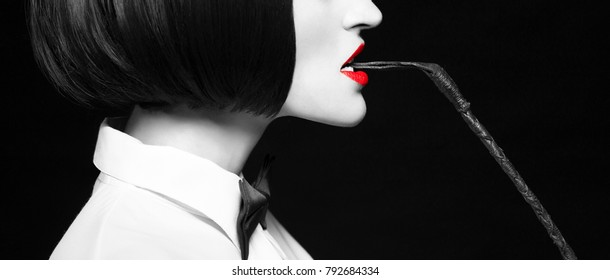 Woman in wig bite whip banner, bdsm, side view, selective coloring with red lips