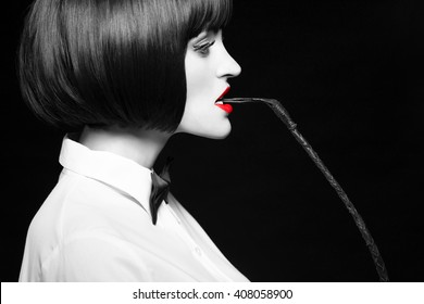 Woman in wig bite whip, bdsm, side view, selective coloring with red lips