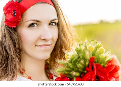 Woman in wild beautiful poppy field