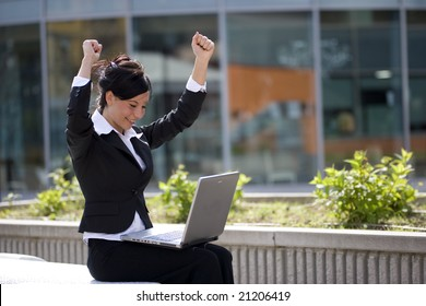 woman win working at a laptop