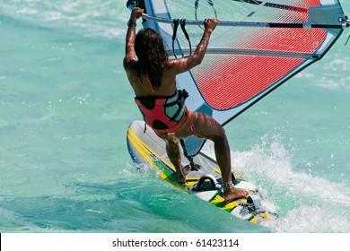 Woman windsurfing in the lagoon