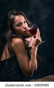 woman with wine glass in hand