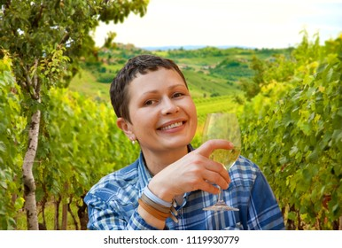Woman with wine glass in a vineyards