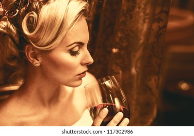 Woman with wine in restaurant
