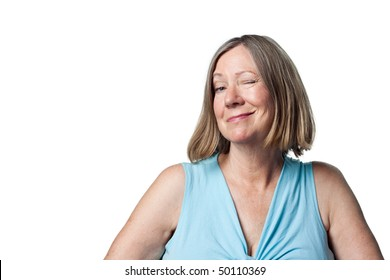 Woman winks at the camera in a playful flirtatious, knowing way