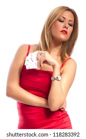 Woman winning - Young woman in a classy red dress holding four aces, a poker of aces card combination. Studio shot on white background