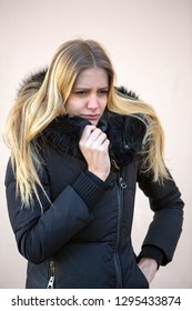 Woman in winter being cold