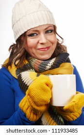 Woman in winter clothes with a cup of tea